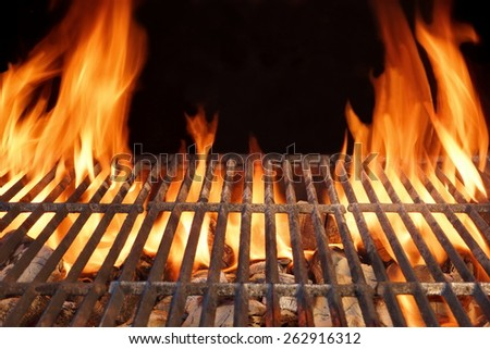 Flaming Empty Hot Barbecue Charcoal Grill With Glowing Coals On Black Background - stock photo