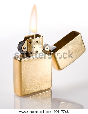 Flaming golden lighter on a white background - stock photo