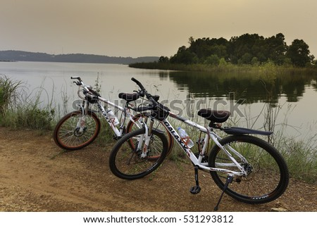 Flamingo Dai Lai, Vinh Phuc, Vietnam - October 10, 2016: Two bicycles beside the lake at sunset