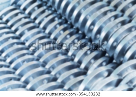 Flanges stacked in warehouse, blured background. - stock photo