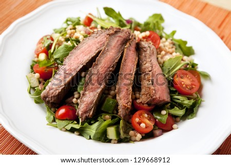 Flank Steak Salad with Israeli Couscous - stock photo