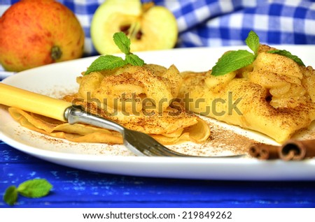 Flapjacks with apple and cinnamon on a white plate. - stock photo