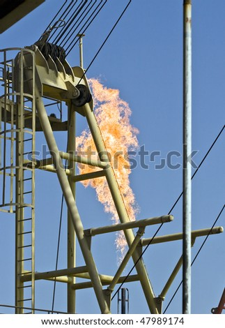 Flare burning natural gas to the atmosphere on an oil production platform
