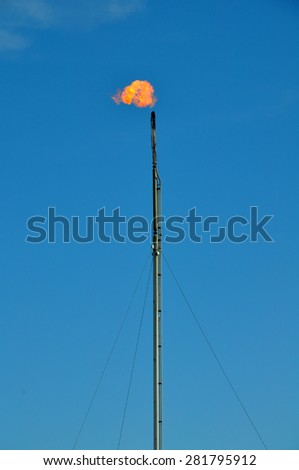 Flare stack - stock photo