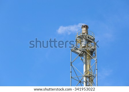 Flare stack with blue sky