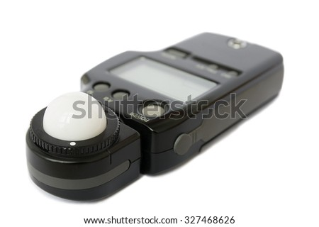 Flash meter -  device for measuring illumination. Photo concept.