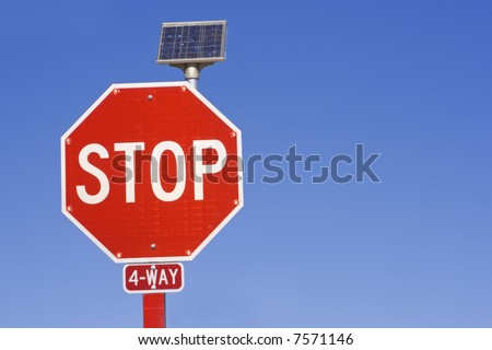 Flashing STOP sign powered by a solar battery.