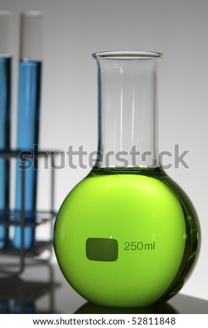 flask and test tubes with color liquid - stock photo