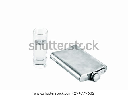 Flask of vodka and a glass on white