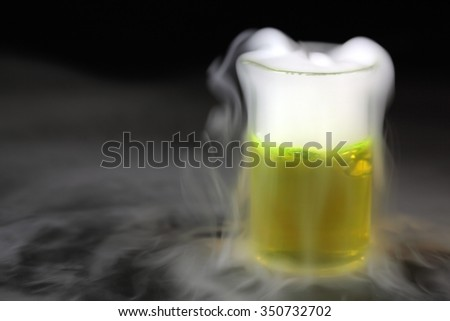 Flask with a fog of dry ice. - stock photo