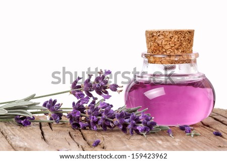 Flask with lavender essence - stock photo