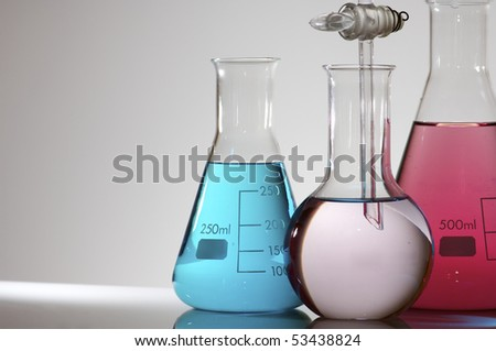 flasks group with color liquid and white background
