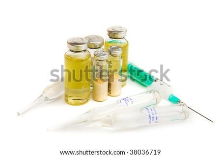 Flasks with medicines and syringe - stock photo