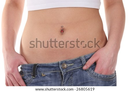 Flat and sexy girl's belly with piercing with jeans
