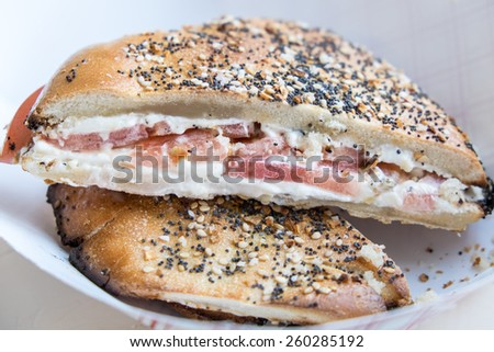 Flat bagel sandwich with cream cheese and tomato - stock photo
