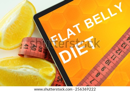 flat belly diet on tablet. - stock photo