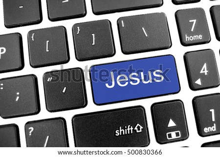 Flat black modern Keyboard of a laptop with Blue Button: Jesus
