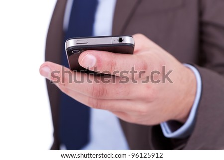 Flat cell phone in business man hand on white background - stock photo