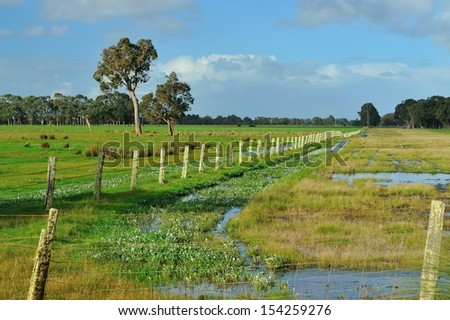 flat farmland with standing water - stock photo
