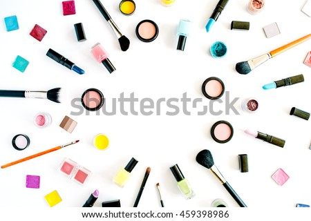 flat lay female cosmetics collage frame with lipstick, brush on white background. top view set