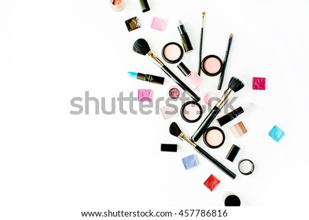 flat lay female cosmetics collage with lipstick, brush on white background. top view set