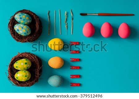 Flat lay of Easter eggs on blue background - stock photo