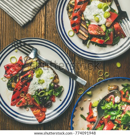 Flat-lay of healthy dinner table setting. Green salad grilled vegetables with yogurt : healthy dinner plates - pezcame.com