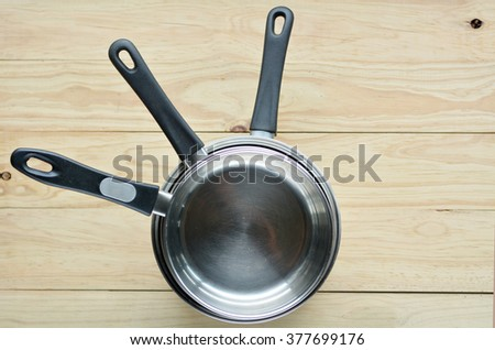 Flat lay of three pots stack on top of each other. Cooking concept Copy space - stock photo