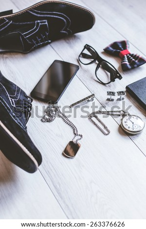 Flat lay shot of Men fashion. Men accessories. Men shoes, wallet, cuffs, pocket watch, bow tie, mobile phone and necklace. Still life. Business look.  - stock photo