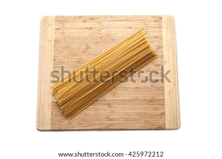 flat lay spagetti isolated on wooden surface