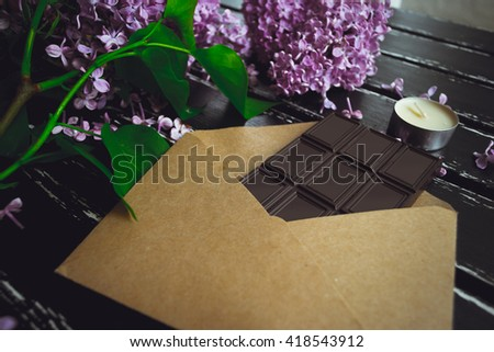 Flat lay. Texture.Letter lying on the table. Chocolate and colors on the flat surface. Photos can be used as a love letter, congratulation happy mother Happy Valentine's. an invitation to the wedding. - stock photo
