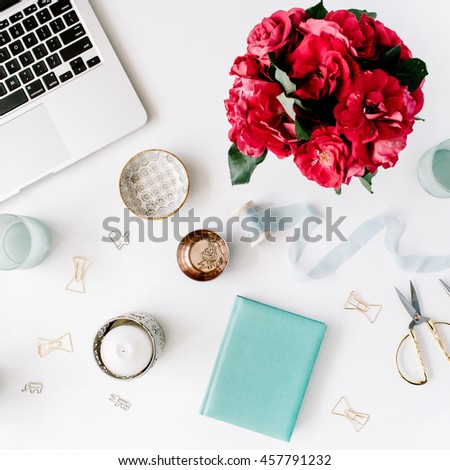 White background workspace with laptop coffee roses in tray white
