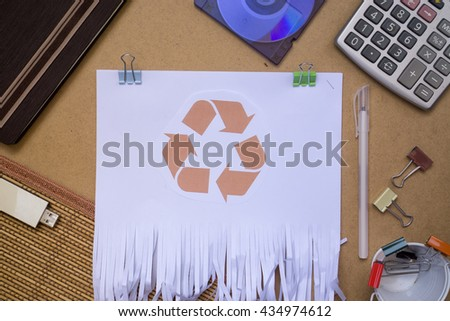 Flat lays image of recycle paper shred of document on brown paper background. with office stationary as prop - stock photo