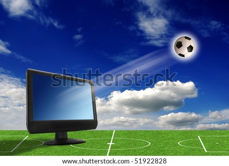 flat monitor on a soccer pitch with a football shooting out - stock photo