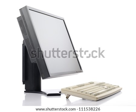 Flat screen LCD monitor with old classic keyboard on white background, isolated path included - stock photo