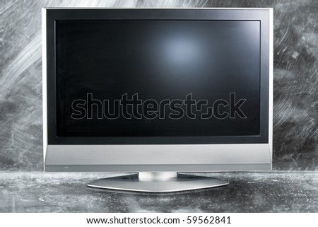 flat screen tv on metal background