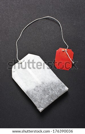 Flat teabag on the dark background