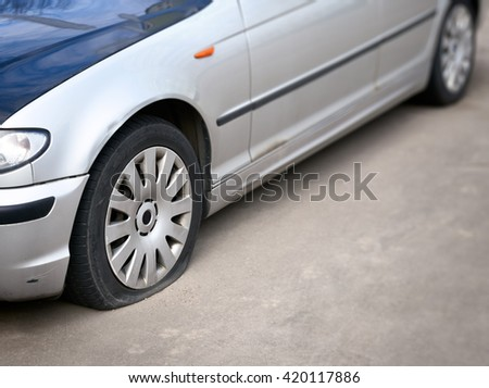flat tire of the car                        - stock photo