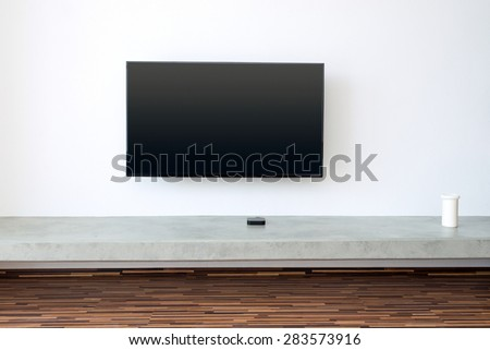 flat TV screen on white wall