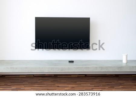 flat TV screen on white wall - stock photo