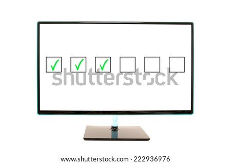 Flat Wide Monitor Screen on Stand Flashing Check Boxes. - stock photo