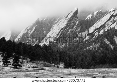 Flatirons of Boulder Colorado in the winter - stock photo