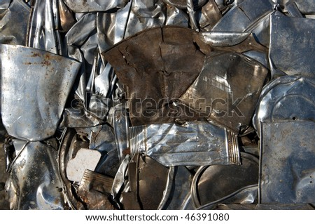 Flattened metal in recycling center - stock photo
