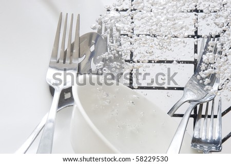 Flatware washing in fresh water - stock photo
