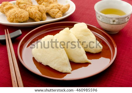 flavored boiled rice wrapped in fried bean curd, chicken cutlet,