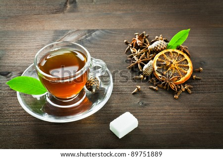 flavored hot tea and anise, cloves and orange - stock photo