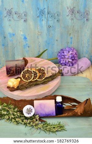 flavorings care and welfare  natural soap rosemary essential oils shell salt and flavorings in rustic wooden background - stock photo