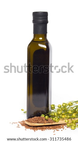 Flax oil and flax seeds isolated on white background  - stock photo