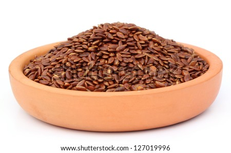 Flax or edible tisi seeds on a clay pottery - stock photo
