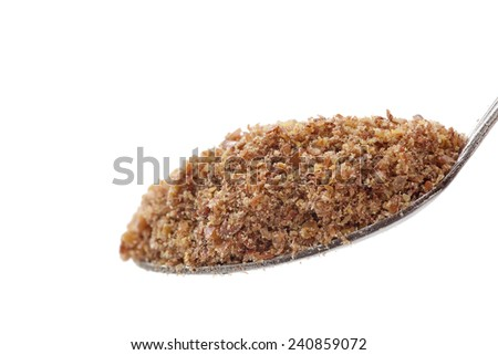 Flax seed in a tea spoon - stock photo